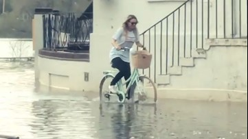 A little flooding won't stop this woman from bicycling