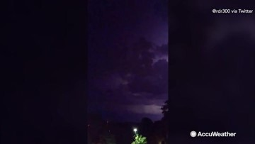 Lightning bolts streak through the sky