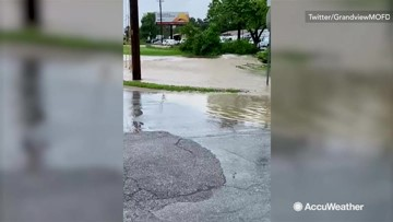 Flooding spills onto roads following storm