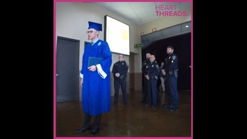 Officers stand in for the graduation of their fallen comrade's son