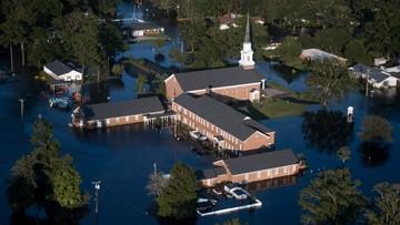 2 women drown as sheriff's van swept into SC flood waters