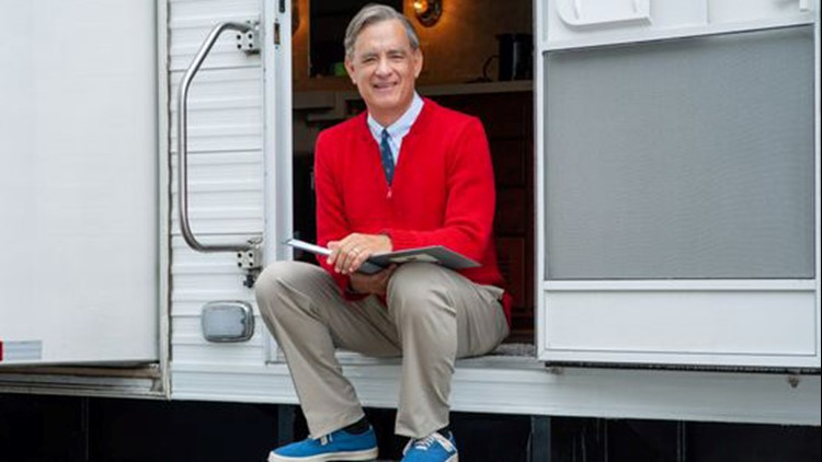 First Photo Of Tom Hanks As Mister Rogers Emerges Red Sweater And All Wfaa Com
