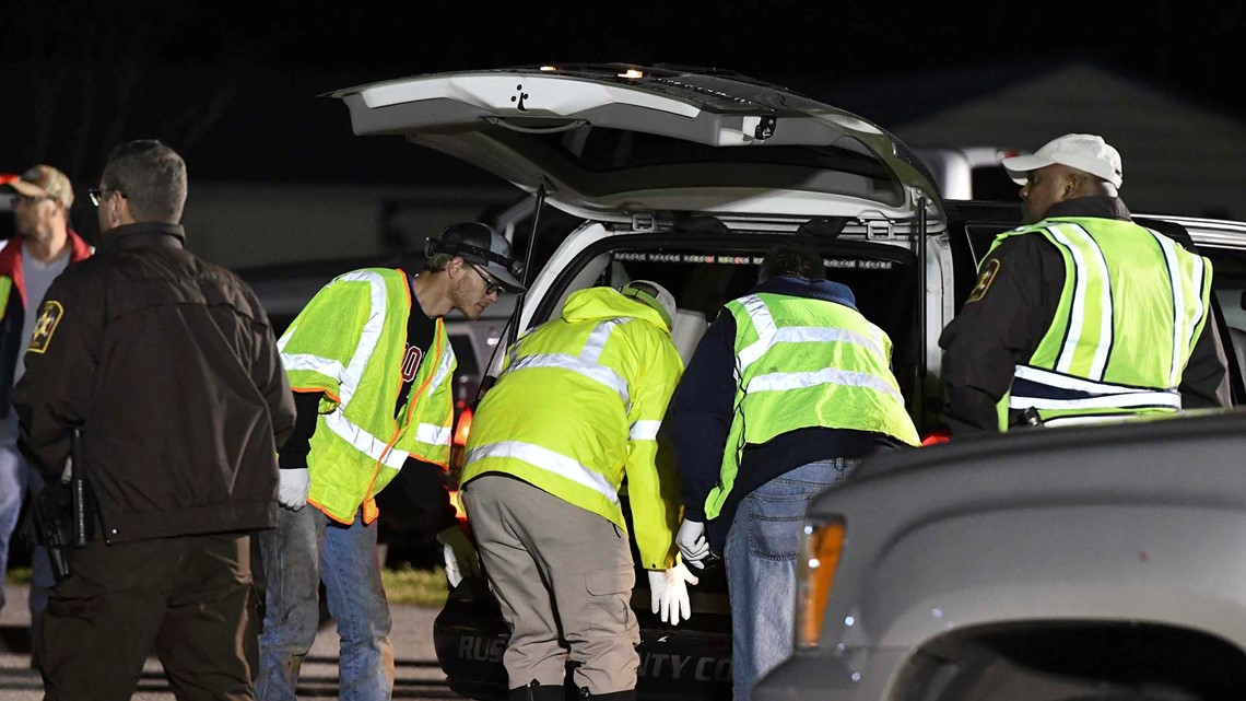 Emergency personnel work the staging area at Sanford Middle School in Beauregard, Ala., Sunday, March 3, 2019, after tornados ravaged the area, ...