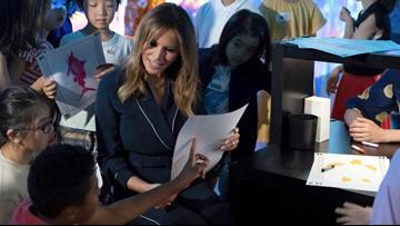 Melania Trump colors fish with kids at Japan digital museum