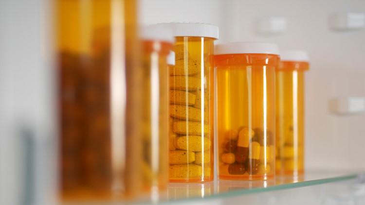 Bottles of pills in cabinet prescription drugs