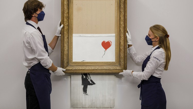 Banksy artwork that shredded itself sells for record amount at auction
