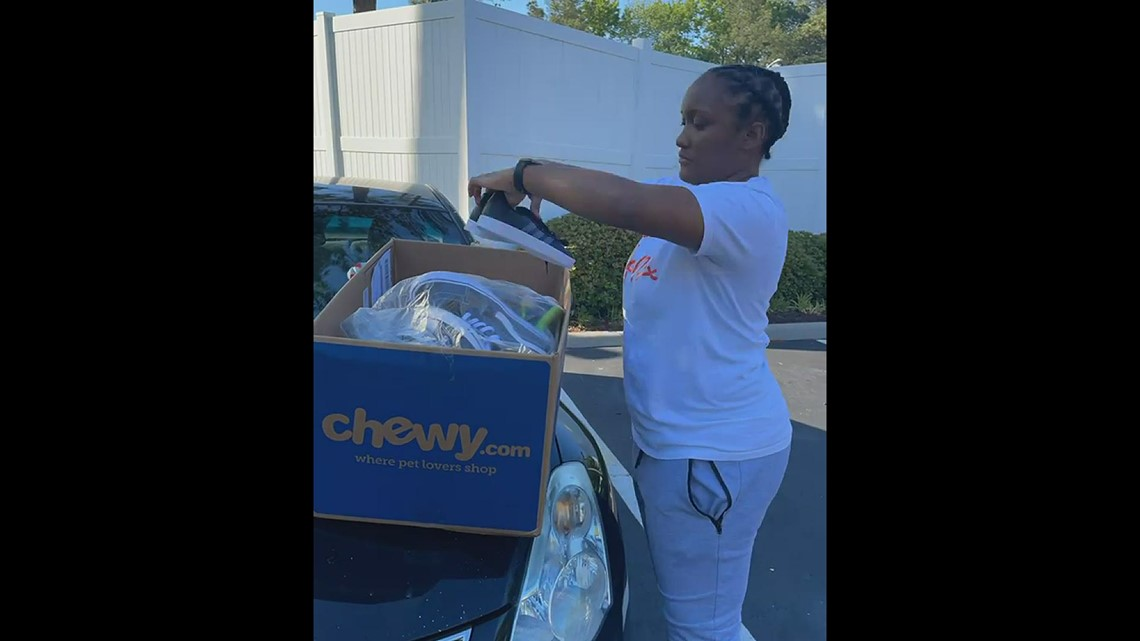 Becca Adams organizes shoes for her Fast Forward shoe drive