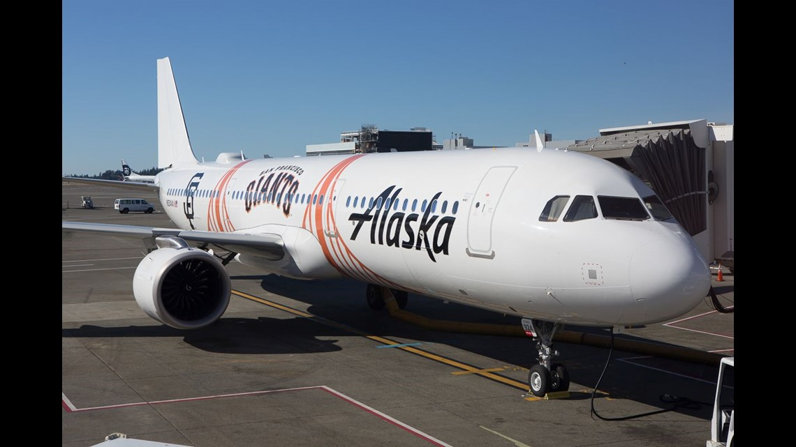 472e1bfe5af6 An Alaska Airlines Airbus A321 painted in the colors of the San Francisco  Giants baseball team rests at a gate in Seattle-Tacoma International Airport  in ...