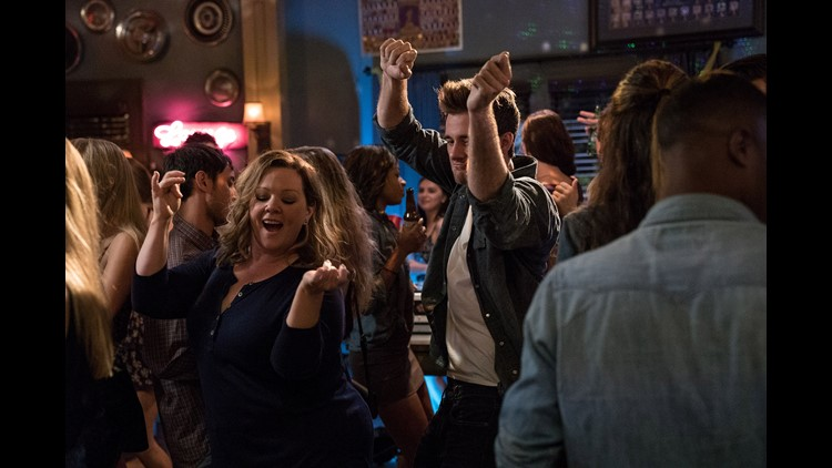 Deanna (Melissa McCarthy, left) gets her groove on with a younger man (Luke  Benward) in