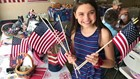 Rochester teen honors her late father with flags