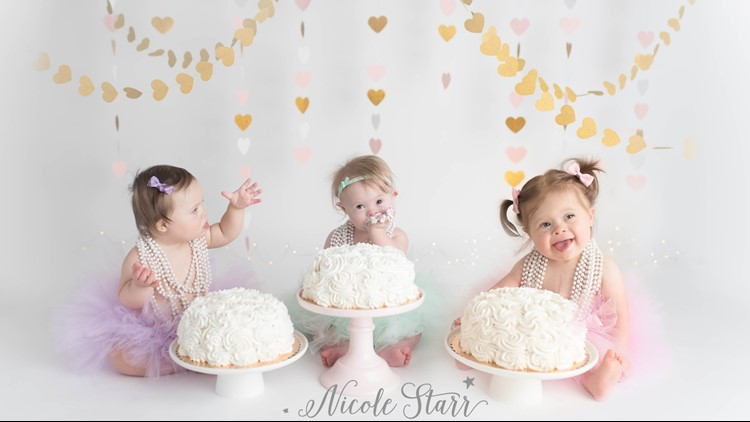"""<p>First birthday photos are always fun, but none will tug at your heart like the """"Three of Hearts"""" triple cake smash snaps by Boston photographer Nicole Starr. Her photo shoot featured Mae, Cate and Harper, three little girls with Down syndrome who were born within three days of each other.</p>"""