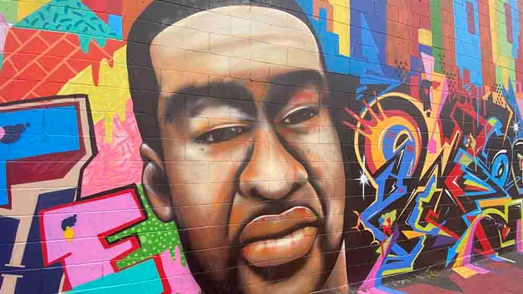 'It's just wrong' | Houston artist paints over racist graffiti on his George Floyd mural