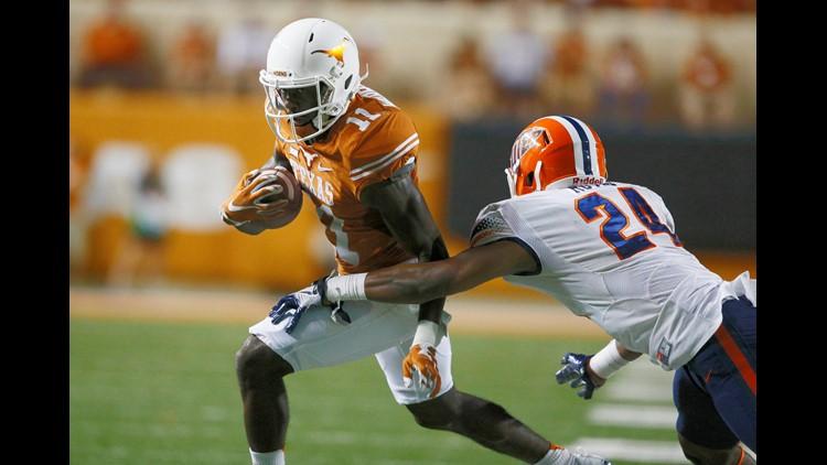 Sep 10, 2016; Austin, TX, USA; Texas Longhorns wide receiver Jacorey Warrick (11) gains yardage against University of Texas at El Paso Miners defensive back Brendan Royal (24) in the fourth quarter at Darrell K Royal-Texas Memorial Stadium.