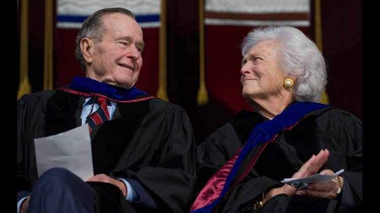 Former President George H.W. Bush and Barbara Bush listen as their son, US President George W. Bush, delivers the commencement address during the Texas A&M University graduation ceremony, on December 12, 2008. (Photo: SAUL LOEB/AFP/Getty Images)
