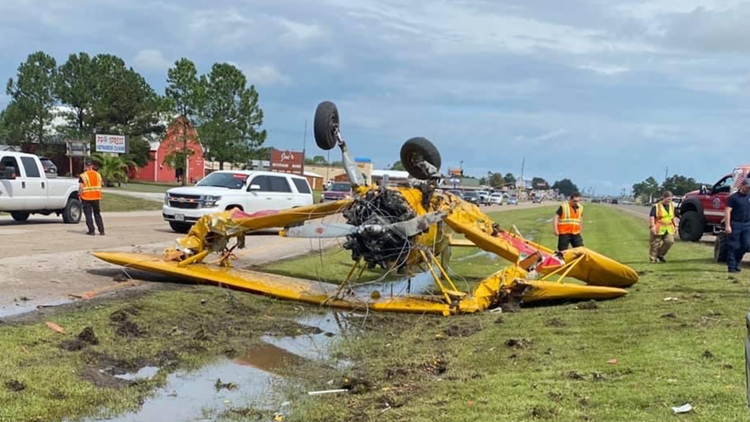 Biplane crashes onto roadway after attempting take off from Highway 124 following Texas Rice Festival parade in Winnie
