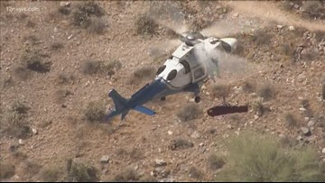 Injured hiker spins mid-air as she's airlifted off Piestewa Peak