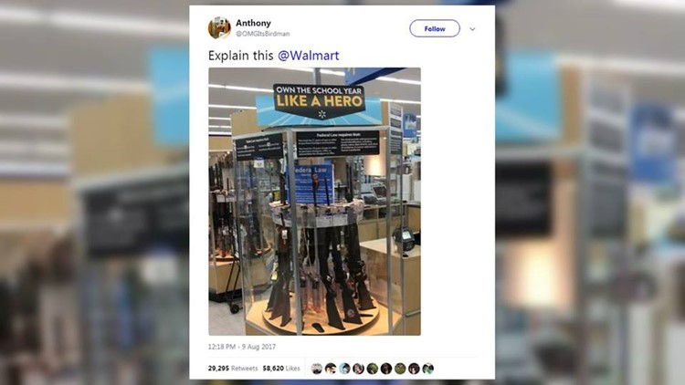 <p>A photo circulating social media showed a sign that read 'Own the school year like a hero', above a display case filled with several guns.</p>