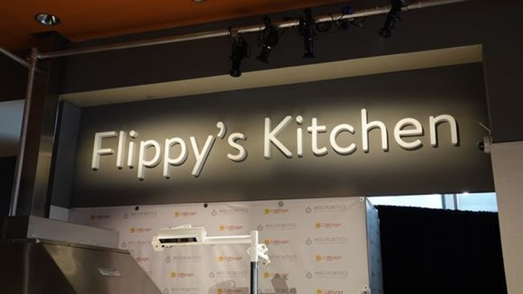 The Pasadena location of Caliburger has a stage devoted to the new robot making hamburgers, 'Flippy's Kitchen.'