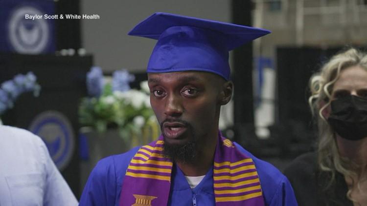 Corey Borner walks across the stage to receive UNT diploma