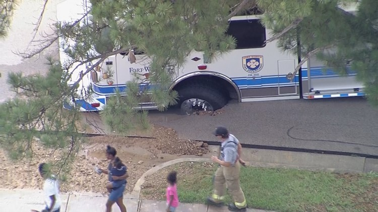 Tire of a Fort Worth fire truck sinks into buckled road