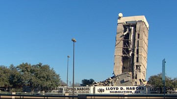 The Leaning Tower of Dallas still hasn't taken its final bow more than 12 hours after it was supposed to fall