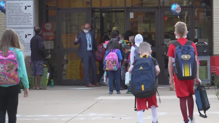Back to school: Thousands of students return to classrooms as COVID-19 remains a concern