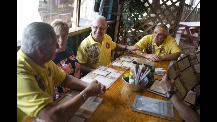 After re-creating the photo on Cinnamon Beach, Dennis Puleo, Puleo's wife, Joanne, Bob Falk, Bob DeVenezia and Tom Hanks (not pictured) all went out to lunch. (Photo: Luke Franke, Naples (Fla.) Daily News)