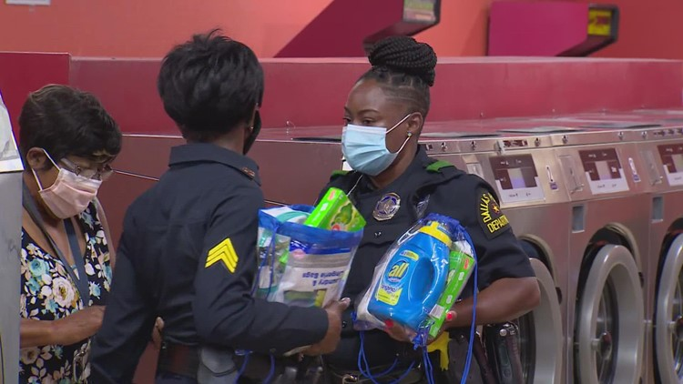 Labor of love: Dallas PD partners with Oak Cliff laundromat for free 'Community Laundry Day'