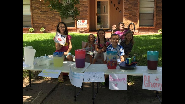 Kids sell Kool-Aid and brownies to raise money for officers and their families in the wake of Thursday's ambush.