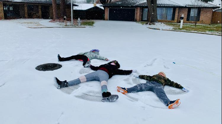 Gallery: North Texans pull out their sleds, scarves to enjoy Sunday snow