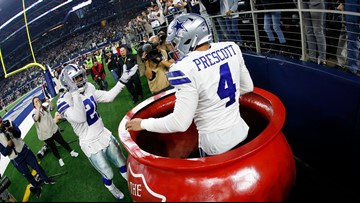 Cowboys receive joy in serving early Thanksgiving at Salvation Army