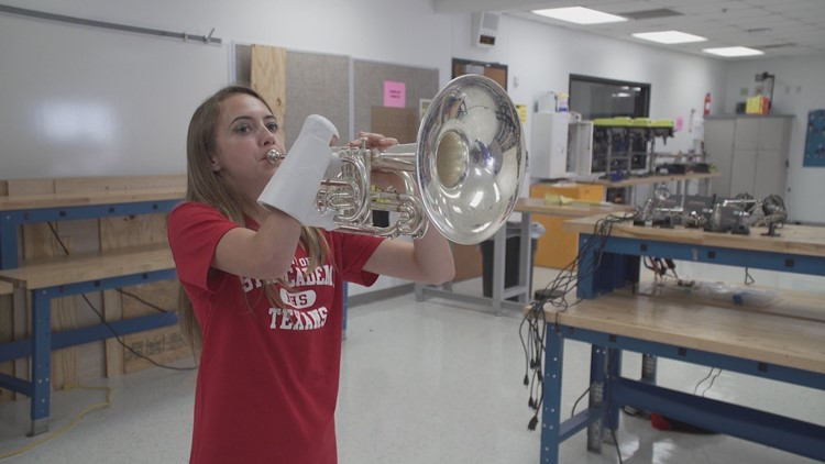 High school STEM student creates prosthetic for fellow student in marching band