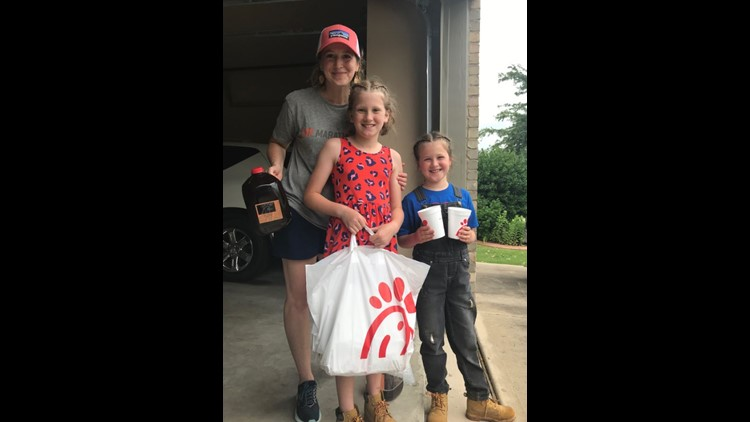 7-year-old Tabitha and her family with their supply of Chick-fil-A to hand out to neighbors who were cleaning up