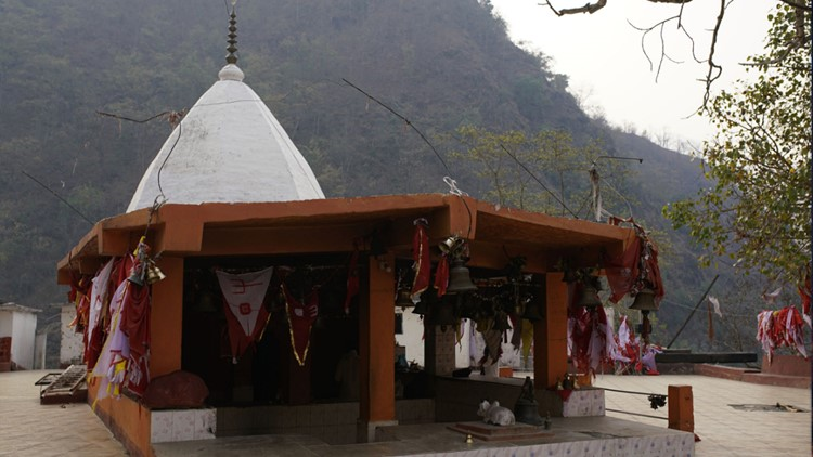 The baba's temple sits a hundred feet above the river, for now.