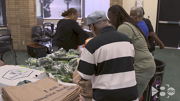 Residents visit the center twice a week to pick up bags of fresh produce.