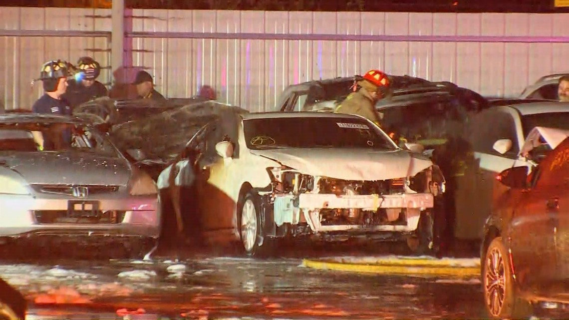 more than a dozen cars on fire at car auction facility in