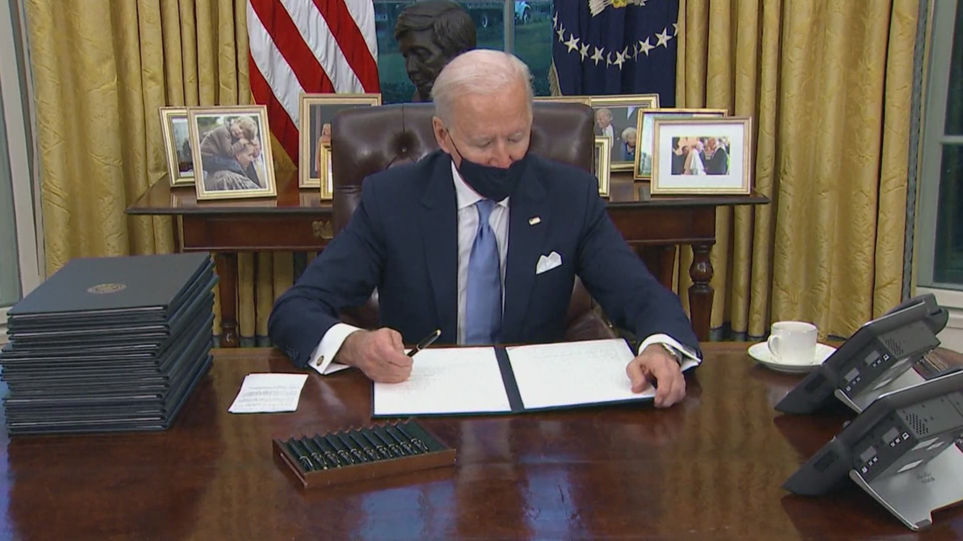President Joe Biden signs executive orders on COVID-19, immigration,  climate change and more | wfaa.com