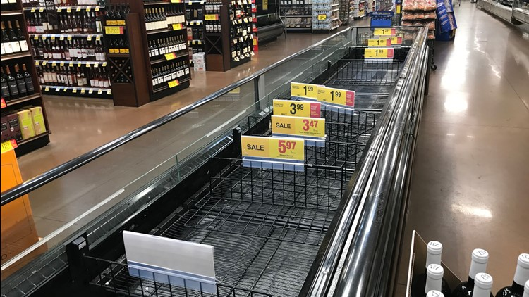 An empty refrigerated case at Kroger on North Haskell Avenue. Poultry, meat and seafood were moved to refrigerated trailers outside after electricity went out in Sunday's brief but powerful storm.