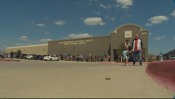 Customers given umbrellas, water as they wait for over an hour outside DPS mega center in triple-digit heat