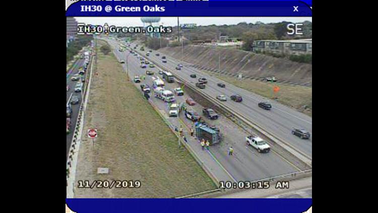 I-30 W shut down in Fort Worth after 18-wheeler overturns, spills gravel