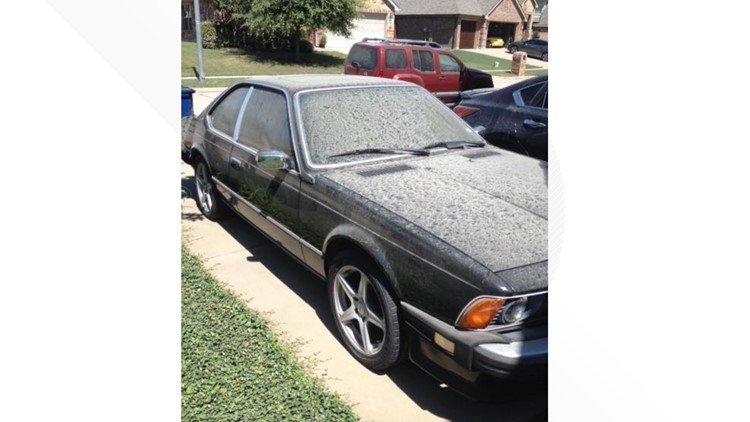 Dust coats a car in McKinney