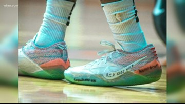 Lancaster senior Mike Miles gives 'Kobe' sneakers to young fan on opposing team