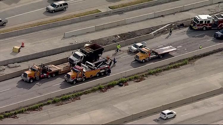 Overturned dump truck creates traffic nightmare on I-30 in Arlington