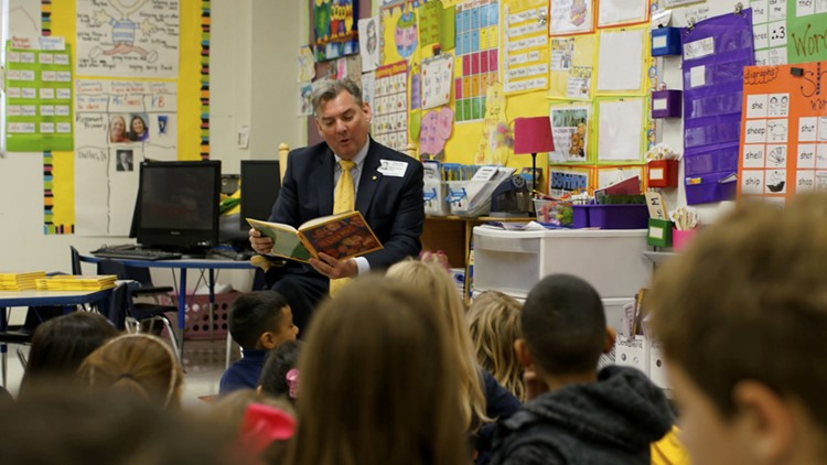 Rotarian Bill Dendy reads Rosemont kindergarteners their own personalized books.
