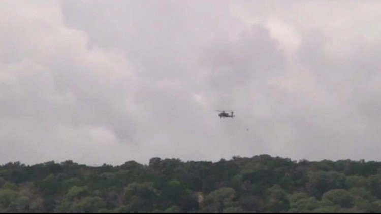 A helicopter flies over the search area.