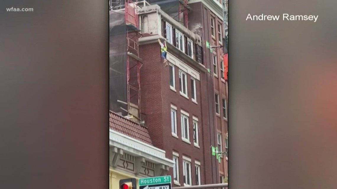 fort worth worker dangles from building after scaffolding
