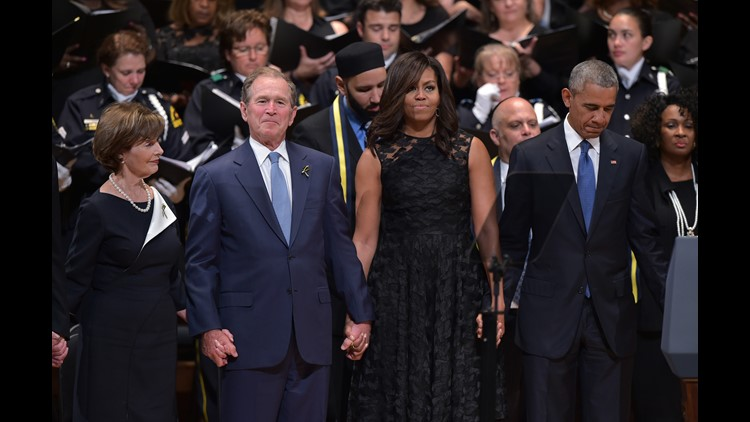 In a non-partisan moment, the Obamas and the Bushes stand together to unite a grieving city and nation at an interfaith ceremony following the July 7, 2016 attack on Dallas police. (Photo: MANDEL NGAN/AFP/Getty Images)