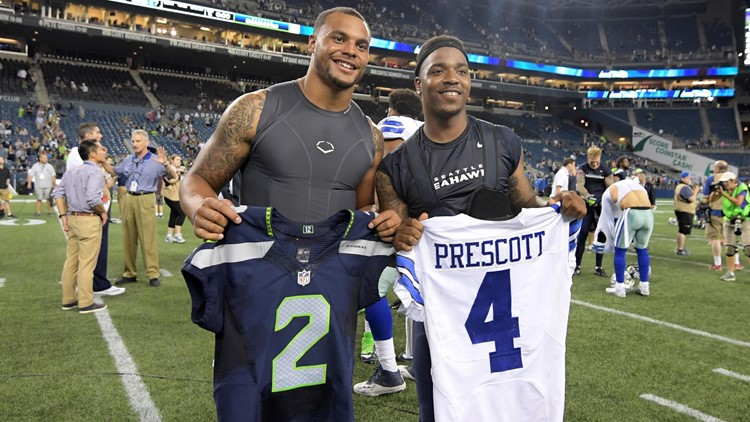 Dallas Cowboys quarterback Dak Prescott (left) and Seattle Seahawks quarterback Trevone Boykin exchange jerseys during a NFL football game at CenturyLink Field. Mandatory Credit: Kirby Lee-USA TODAY Sports