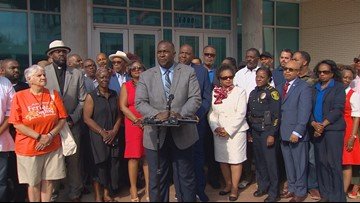 Large group rallies outside Dallas police headquarters in support of Chief Renee Hall