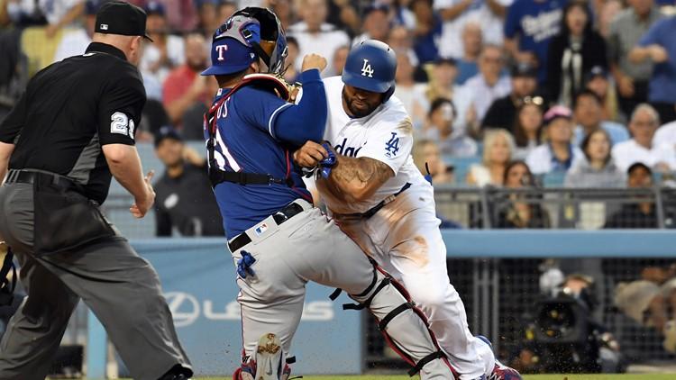 Los Angeles Dodgers left fielder Matt Kemp (27) runs into Texas Rangers catcher Robinson Chirinos (61) in the third inning at Dodger Stadium. Credit: Richard Mackson-USA TODAY Sports